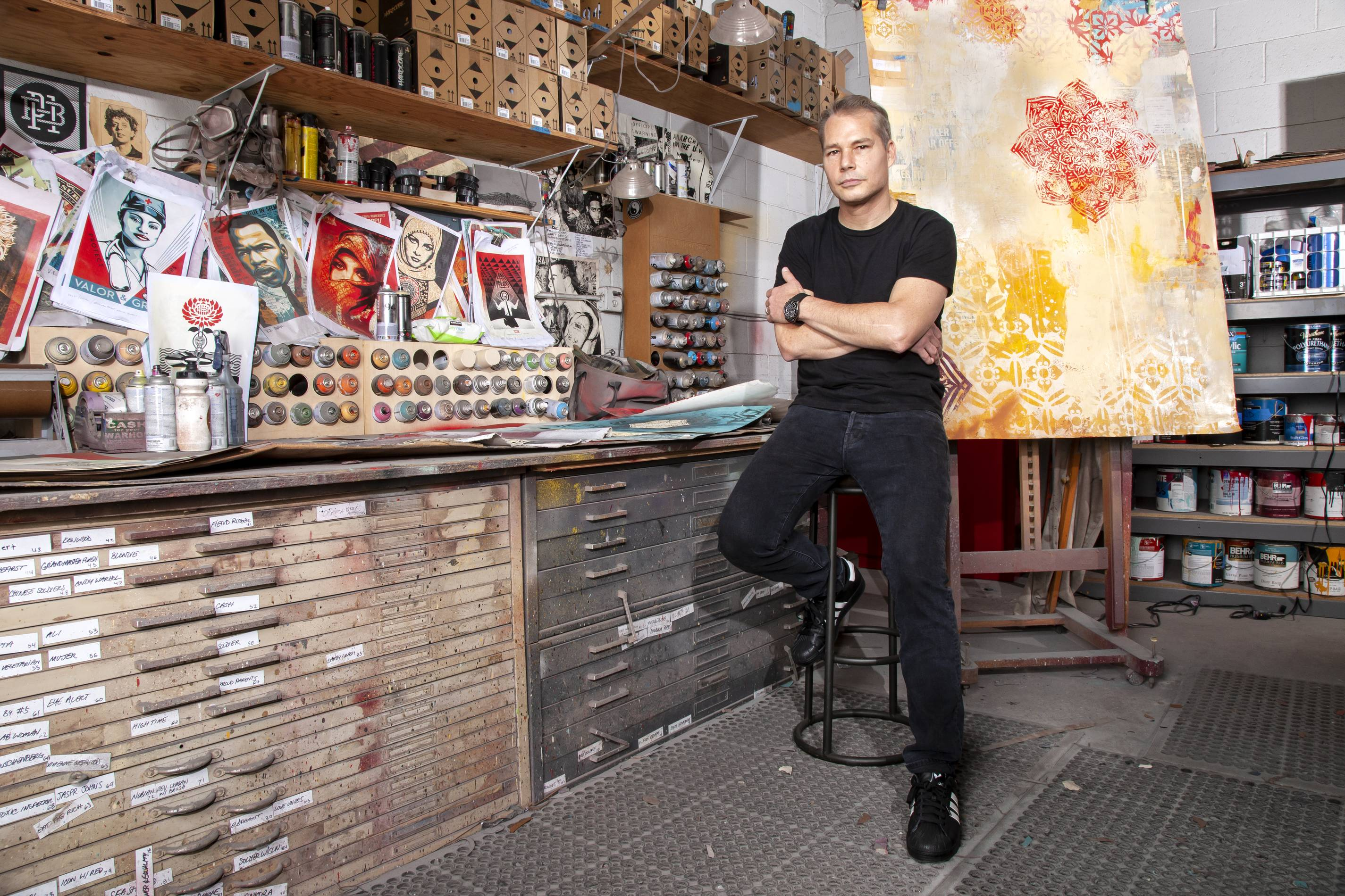Shepard Fairey in his studio wearing Hublot watch collaboration