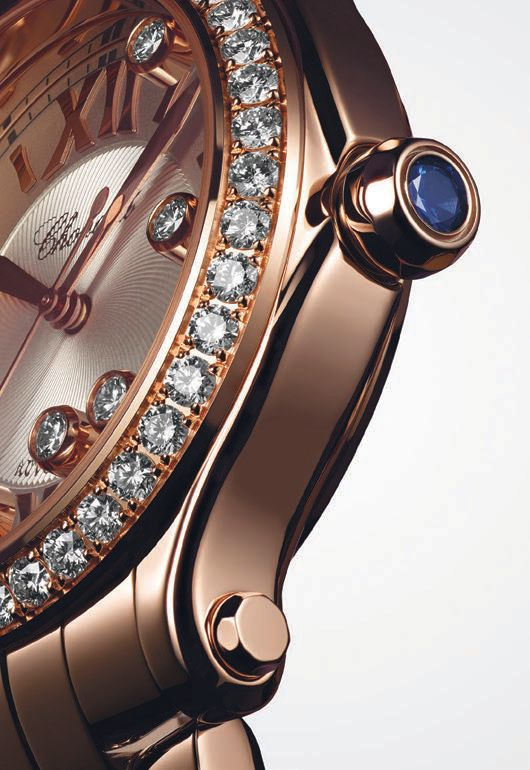 A Happy Sport watch in rose gold featuring the brand's signature dancing diamonds and sapphire crown WATCH PHOTO ©FEDERAL STUDIO