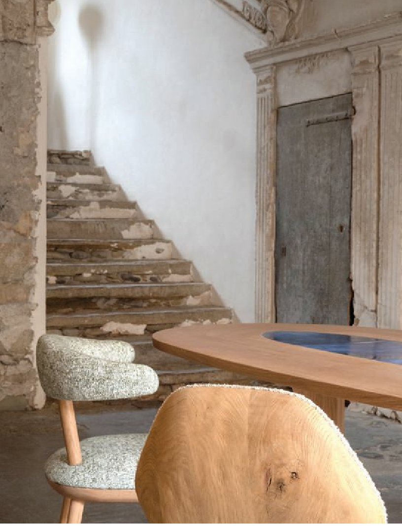 The oiled oak Oopsy chair and Lovebirds table, made from varnished solid oak with a glazed ceramic insert PHOTO BY GIULIO GHIRARDI
