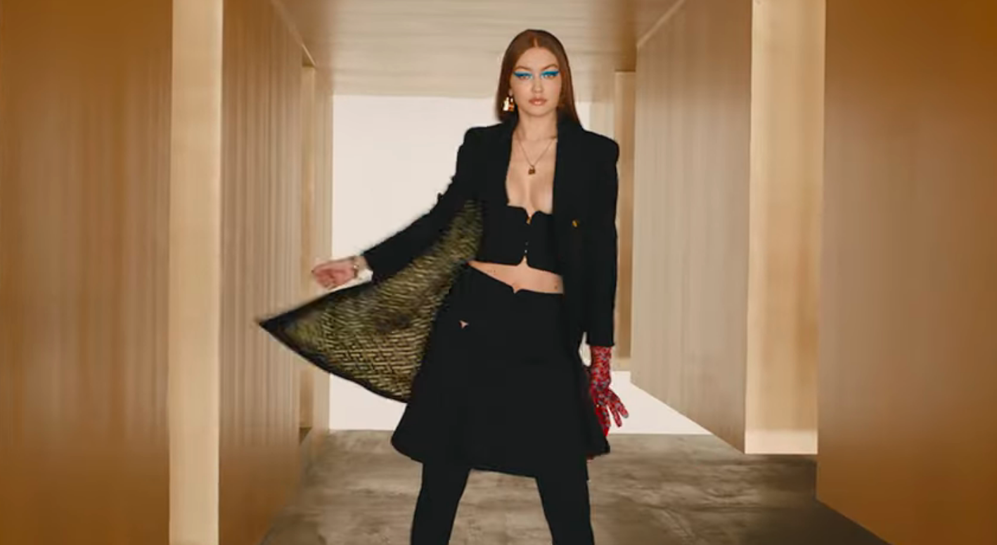 gigi hadid models for versace's fall/winter 2021